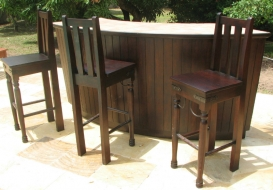 wooden-lined-bar-with-traditional-wrought-iron-bar-stools