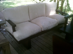 asian-sofa-with-arms-and-tan-microfibre-cushions